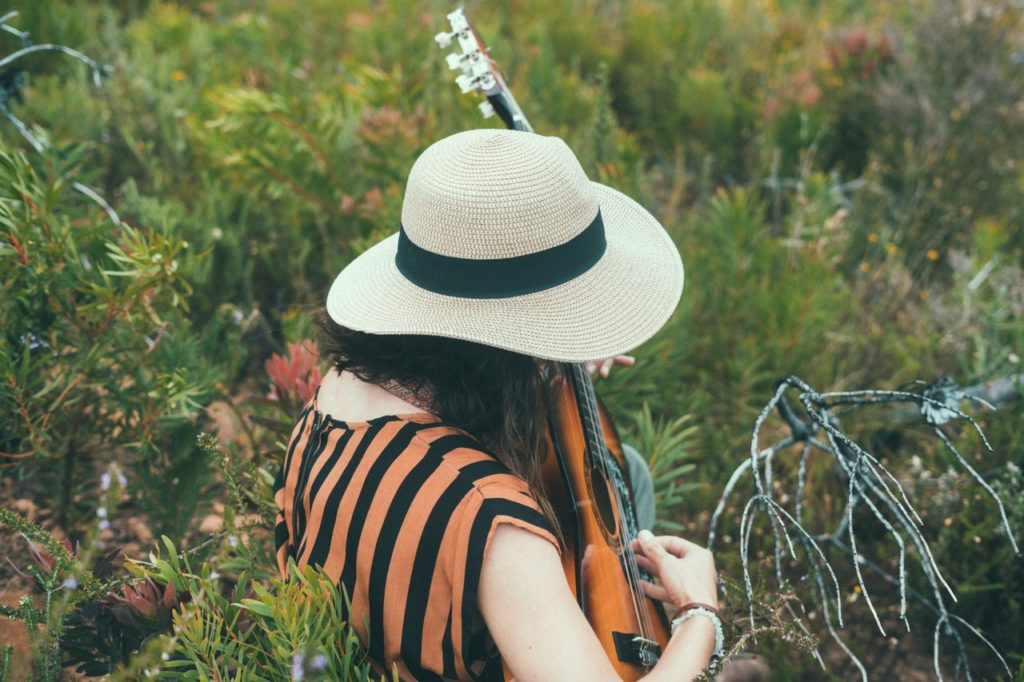 mental health counselling and coaching - personal growth - woman with guitar - kochi gurgaon india